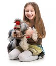 Little girl is with her dog yorkshire terrier isolated on white Royalty Free Stock Image