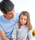 Little girl and her father having fun Stock Photography