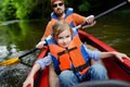 Little girl and her father on a kayak Royalty Free Stock Photo