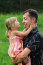 Little girl with her father on the natur Stock Photos