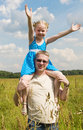 Little girl on her fathers shoulders Royalty Free Stock Photo
