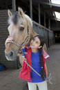 Little girl with her favorite horse Royalty Free Stock Photo