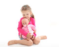 Little girl with her favourite doll isolated over white background Royalty Free Stock Photography