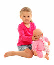 Little girl with her favourite doll isolated over white background Stock Images