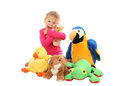 Little girl with her favourite toys stuffed animals isolated over white background Stock Image