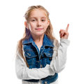 Little girl with her finger pointing upwards Royalty Free Stock Photo