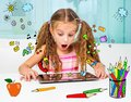 Little girl and her magic tablet surprised Stock Photo