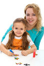Little girl with her mom painting Stock Photo