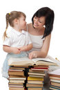 Little girl and her mother with books Royalty Free Stock Photography