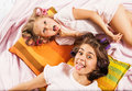 Little girl with her mother playing in bed Royalty Free Stock Photo