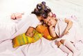 Little girl with her mother slipping in bed Royalty Free Stock Photo