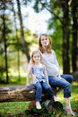 Little girl and her pregnant mother Stock Images