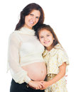 Little girl and her pregnant mother Royalty Free Stock Photo