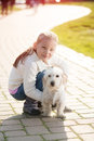 Little girl with her puppy dog in the park Stock Images