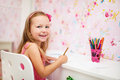 Little girl in her room adorable drawing Stock Photo
