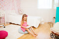 Little girl in her room adorable reading Royalty Free Stock Images