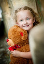 Little girl her teddy sitting front old door Stock Photos