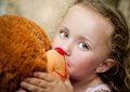 Little girl her teddy sitting front old door Royalty Free Stock Photography