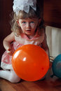 Little girl hide and seek sitting under table playing Royalty Free Stock Images