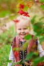 Little girl hiding behind the foliage Royalty Free Stock Photo