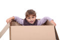 Little girl hiding in a box cardboard Royalty Free Stock Photo