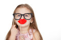 Little girl in hiding her face after fake glasses and paper lips Royalty Free Stock Photo