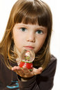 Little girl hold Santa claus figurine Royalty Free Stock Images
