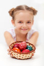 Little girl holding a basket with dyed easter eggs and decorated shallow depth Stock Photography