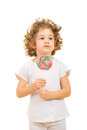 Little girl holding big lollipop with curly hair isolated on white background Royalty Free Stock Photo