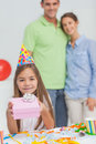 Little girl holding a birthday gift during her Stock Photo