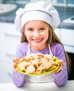 Little girl holding a bowl with cookies cute Stock Photography