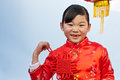 Little girl holding chinese knot Royalty Free Stock Image