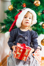 Little Girl Holding a Christmas Gift Royalty Free Stock Images