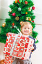 Little Girl Holding a Christmas Gift Royalty Free Stock Photo