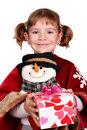 Little girl holding a Christmas present Royalty Free Stock Photos