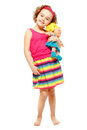 Little girl holding a doll. White background Royalty Free Stock Photo