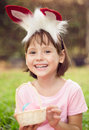 Little girl holding easter eggs and laugh Royalty Free Stock Photos