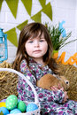 Little girl holding a fluffy rabbit Easter Spring concept Royalty Free Stock Photo