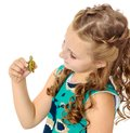 Little girl holding in hands a small turtle. Royalty Free Stock Photo