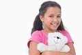 Little girl holding her teddy bear on white background Stock Image