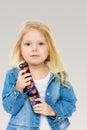 Little girl holding a kaleidoscope.