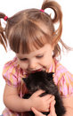 Little girl holding kitten Stock Photo