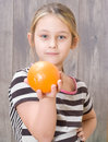 Little girl holding an orange Stock Photography