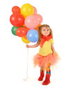 Little girl holding party balloons on white a is rainbow helium a isolated background for a birthday or fun concept the child is Royalty Free Stock Photography