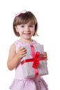 Little girl holding present box smiling Stock Photography