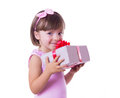 Little girl holding present box smiling over white Royalty Free Stock Photography