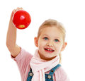 Little girl holding a red apple.