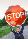 Little girl holding a red sign Royalty Free Stock Photo