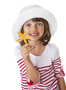Little girl holding a starfish Royalty Free Stock Photo