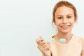 Little girl holding Teeh Brush. Happy girl brushing her teeth